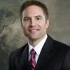 Dr. Brian E. Straus, M.D.